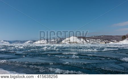 Spring. The Ice On The River Is Cracked, Melting Snow Is Gathering Between The Ice Floes. Snow-cover