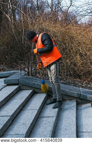 Dnepropetrovsk, Ukraine - 03.16.2021: Municipal Services Are Cleaning The City After Winter. A Worke