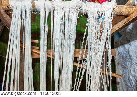 Elastic Cords For A Weaving Shed . White Threats For Weaving Traditional Carpet