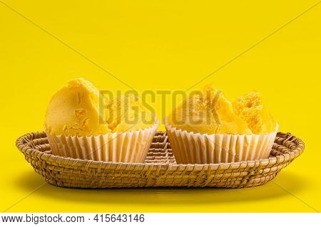 Yellow Collection. Side View Of Egg Yolk Threads Yellow Cotton Candy Cake In Bamboo Tray On Yellow B