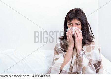 Sick Day At Home. Sick Caucasian Woman Holding Paper Handkerchief Blowing Her Nose, Feeling Unhealth