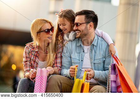 Happy Family With Shopping Bags In The City.people,love,sale,happiness And Lifestyle Concept.