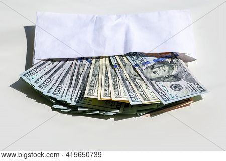 Money In An Envelope. Dollars In An Envelope. Bundle Of Dollars. Dollars Are Fanned Out From A Confe