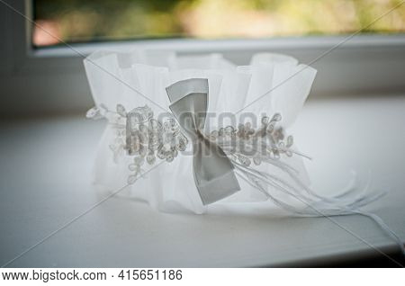 White Wedding Garter On The White Windowsill