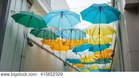 Street Decorated With Colored Umbrellas. View Of Umbrella Street.