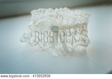 White Garter With Heart On The Table