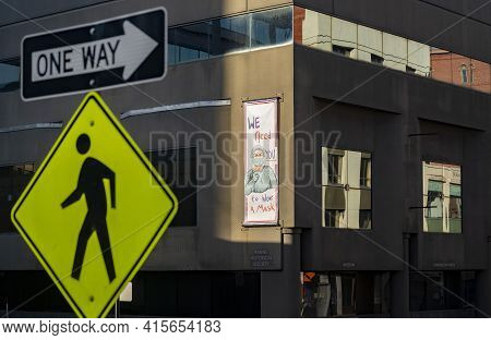Portland, Me - March 27, 2021: Portland Mask Up Sign On Building And On The Streets In The Maine Ciy