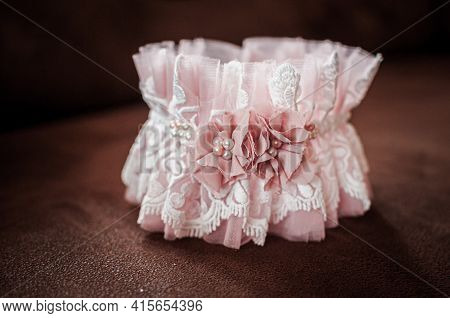 Peach Color Garter Lying On The Wooden Table