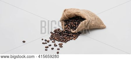 Hessian Sack Bag With Roasted Coffee Beans On White, Banner.