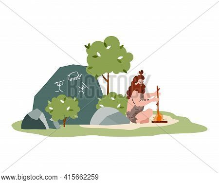 Primitive Cave Man Of Stone Age Sitting Near Fire And Rock With Art Drawings.