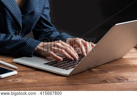 Business Lady Typing On Laptop Computer At Wooden Desk. Strategy Planning And Banking. Financial Ana