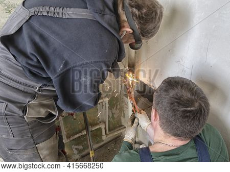 Worker Cutting Steel Pipe Using Metal Torch
