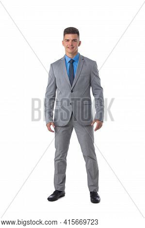 Full Length Portrait Of A Young Business Man In Gray Suit Isolated On White Background