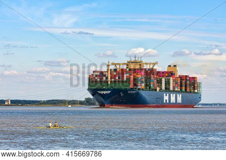 Stade, Germany - June 10, 2020:  HMM ALGECIRAS,  with a capacity of 24,000 TEU the largest container ship worldwide operated by Hyundai Merchant marine on Elbe river near Hamburg.