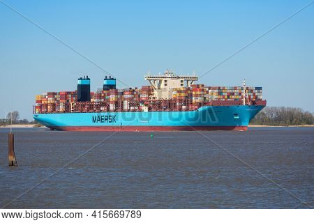 Stade, Germany - April 22, 2020: Container ship MORTEN MÆRSK on Elbe river heading to Hamburg. It is one of 31 Maersk Triple E-class container ships