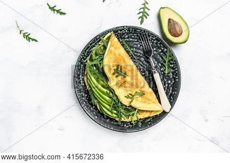 Breakfast. Omelette With Avocado And Arugula. Delicious Vegan, Vegetarian Breakfast Frittata. Tasty