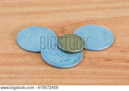 Coins Of The Ukrainian Hryvnia On Wooden Table.
