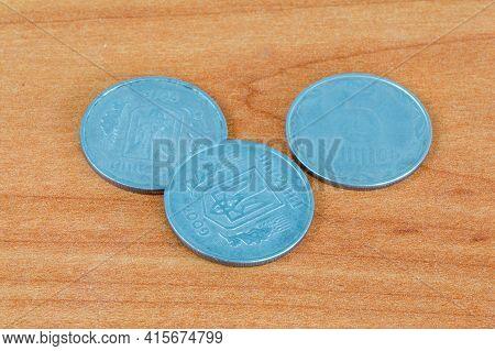5 Kopiyok Coins Of The Ukrainian Hryvnia On Wooden Table.