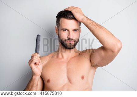 Photo Of Young Handsome Man Hold Hairbrush Enjoy Haircare Shampoo Conditioner Isolated Over Grey Col