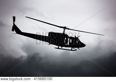 Untitled Helicopter Flying In The Sky Photo. Helicopter With No Markings. Silhouette Shot. Heli With