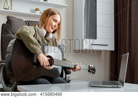Teenager Girl Learning Play Guitar At Home Using Online Lessons. Hobby Remote Musical Education Acou