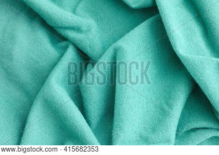 Cyan Crumpled Fabric Texture Background. Close Up.