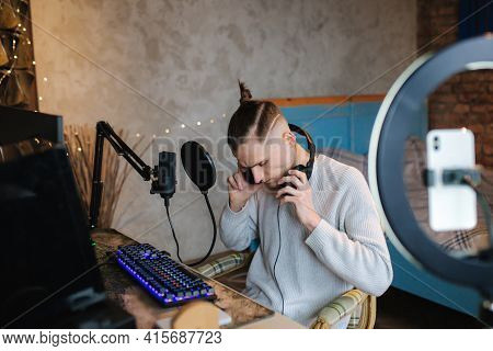Man Recording Video On Smartphone During The Work At Home On Computer. Young Guy Recording On Profes