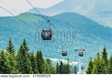 Cable Car Or Funicular In Bachledova Valley With Mountains On The Background. Bachledka Gondola Cabl