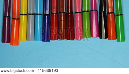 Markers Of Different Colors On A Blue Background, View From Above. Imagination, Creativity, Art. The