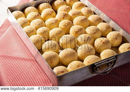 Cheese Bread, Shape Filled With Cheese Bread That Has Just Come Out Of The Oven On A Checkered Table