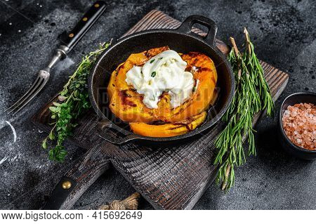 Cheese Mozzarella Burrata And Baked Pumpkin Salad. Black Background. Top View
