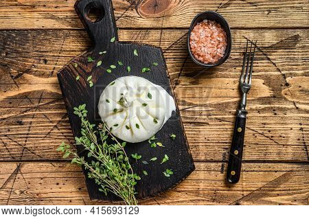 Cheese Burrata Mozzarella On A Wooden Cutting Board. Wooden Background. Top View