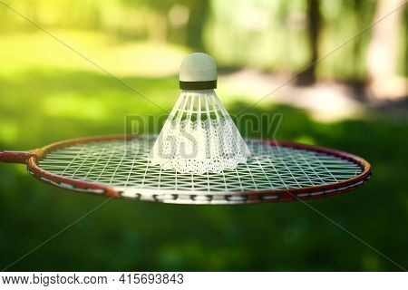 Shuttlecock For Playing Badminton Lies On Racket. Concept Healthy Lifestyle. Fitness Concept. Close-