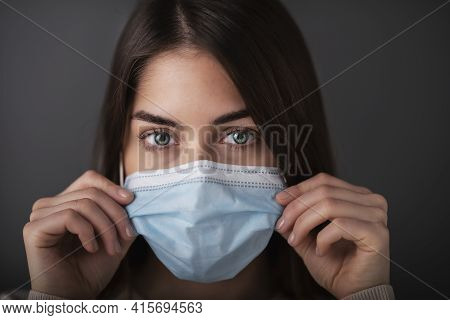 Young Woman Studio Portrait While Wearing Face Mask