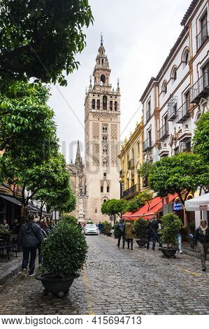Seville, Spain - 06 April, 2019: The Giralda Is The Bell Tower Of Seville Cathedral In Seville, Spai