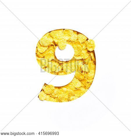 Number Nine Made Of Corn Flakes, Paper Cut In Shape Of Ninth Numeral Isolated On White. Typeface For