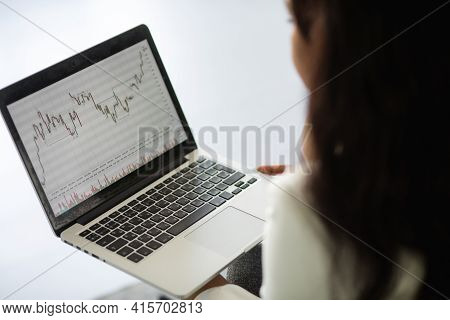 Black Business Woman Using Laptop For Analyzing Data Stock Market, Forex Trading Graph, Stock Exchan