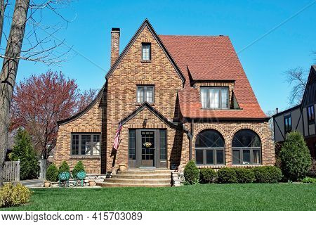 Brown Brick House with Arched Windows