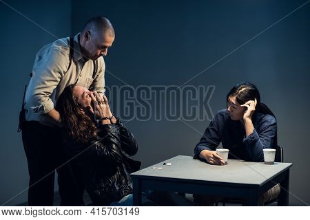 A Mad Criminal Under Interrogation, A Police Officer Got Up And Approached Him From Behind