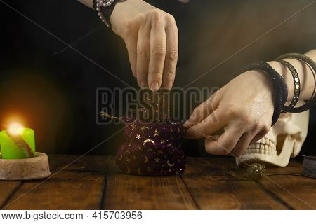 Fortuneteller's Hands. The Fortune Teller Opens A Bag Of Herbs, A Magic Potion. Psychic Readings And