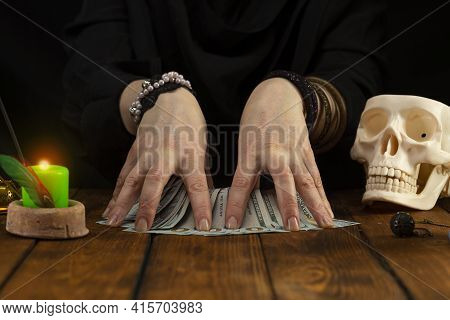 Fortuneteller's Hands And Divination Cards On A Wooden Table. Divination Concept, Tarot Cards, Psych