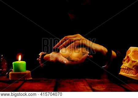 A Fortune-teller Or Oracle With Objects For Fortune-telling Holds A Baby Doll In Her Hands During Th