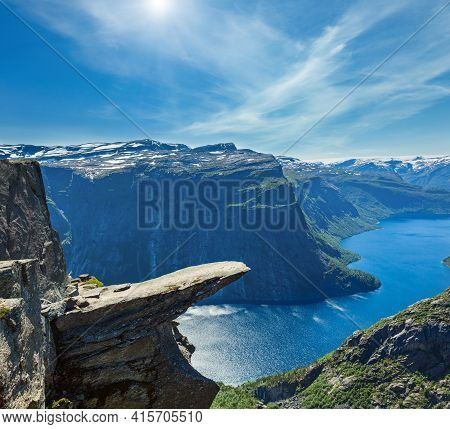The Summer Sunshiny View Of Trolltunga (famous The Troll's Tongue Norvegian Destination) And Ringeda