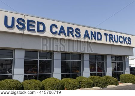 Used Car And Trucks Sign At A Used Car Dealership.