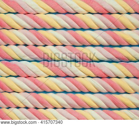 Marshmallow Background. Sweet Candy Colorful Texture. Rainbow Colored Marshmallow Twists. Close Up.
