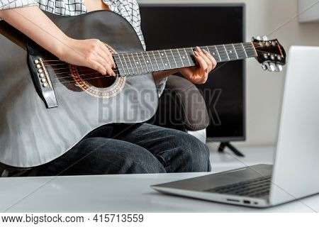 Online Musical Guitar Performance. Young Woman Plays Acoustic Guitar At Home For Online Audience On