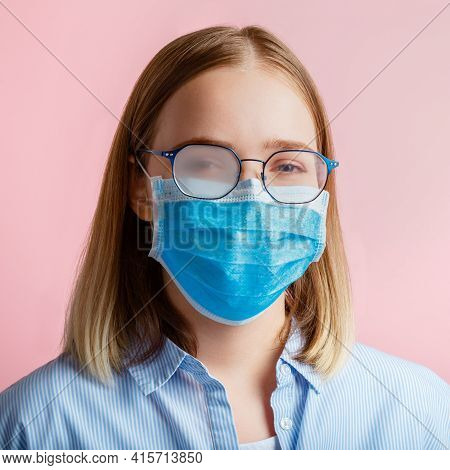 Foggy Glasses Wearing On Woman. Woman In Medical Protective Face Mask And Eyeglasses Wipes Blurred F