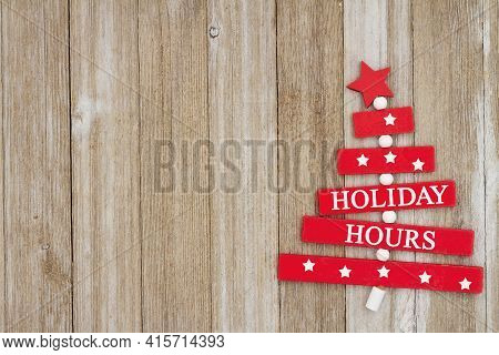 Holiday Hours Message With A Wood Christmas Tree On Weathered Wood Sign With Space To List Your Hour