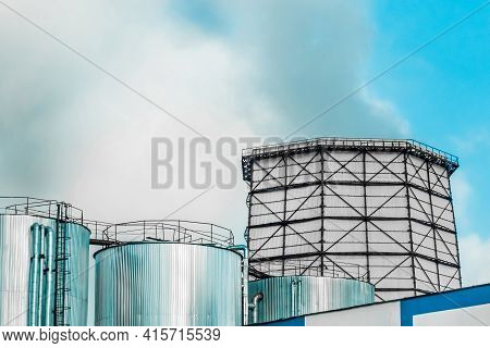 Cooling Tower, Desuperheater, Smoke From A Pipe Of An Industrial Plant Or Thermal Power Plant On A B