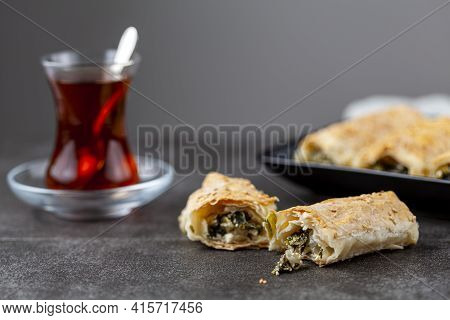 Traditional Turkish Spinach Pastry Rolls ( Ispanakli Borek ) Served On A Porcelain Plate. Homemade R